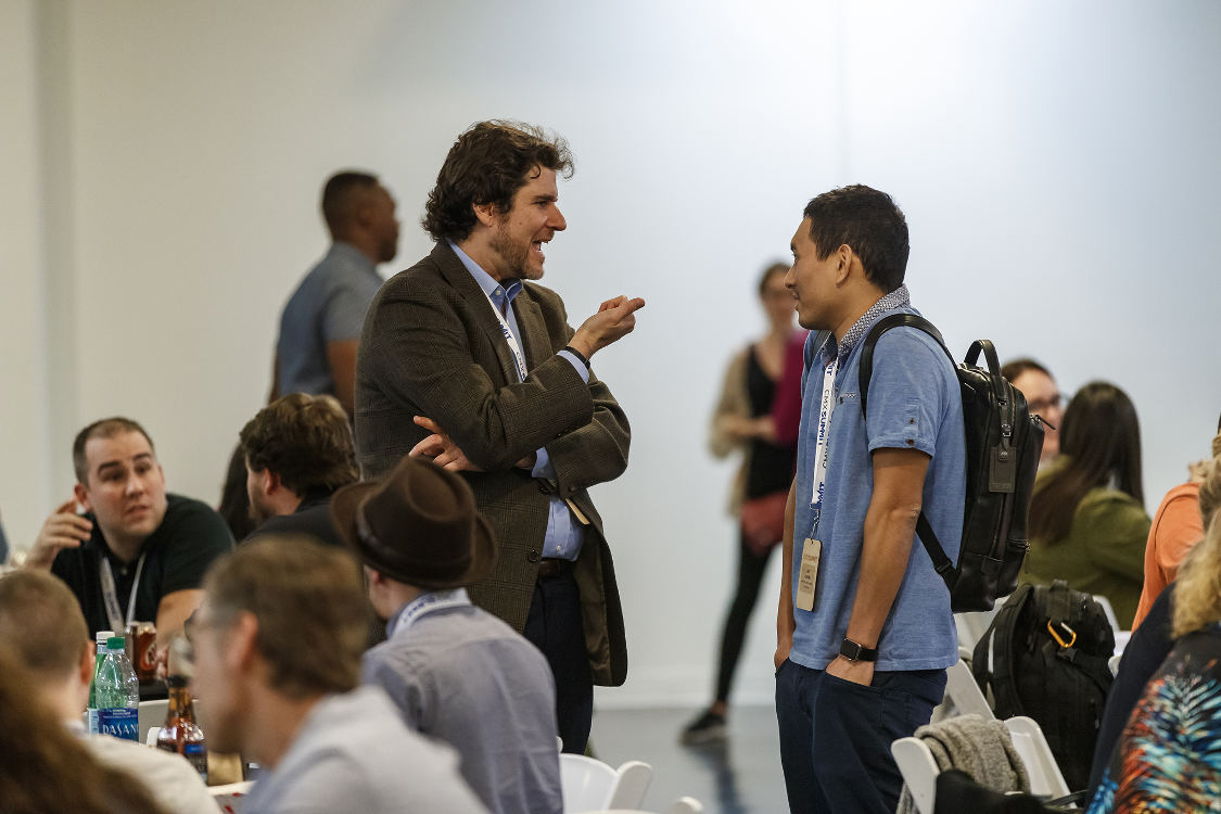Michael Margolis chats with an attendee.
